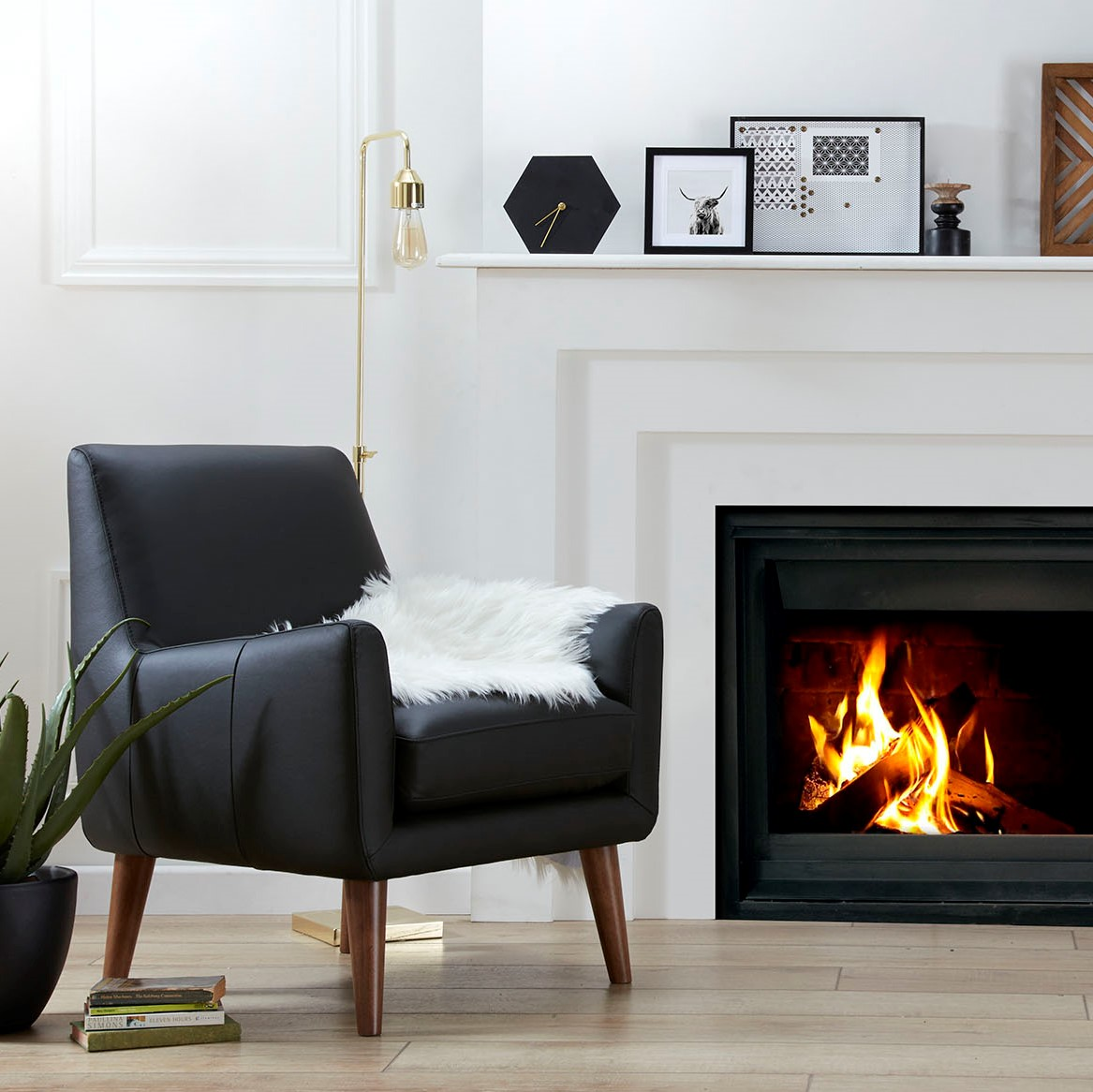 black armchair close to a fireplace